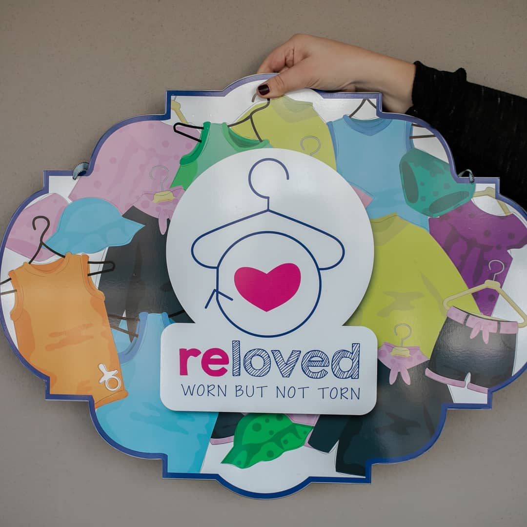 Reloved secondhand clothing store sign