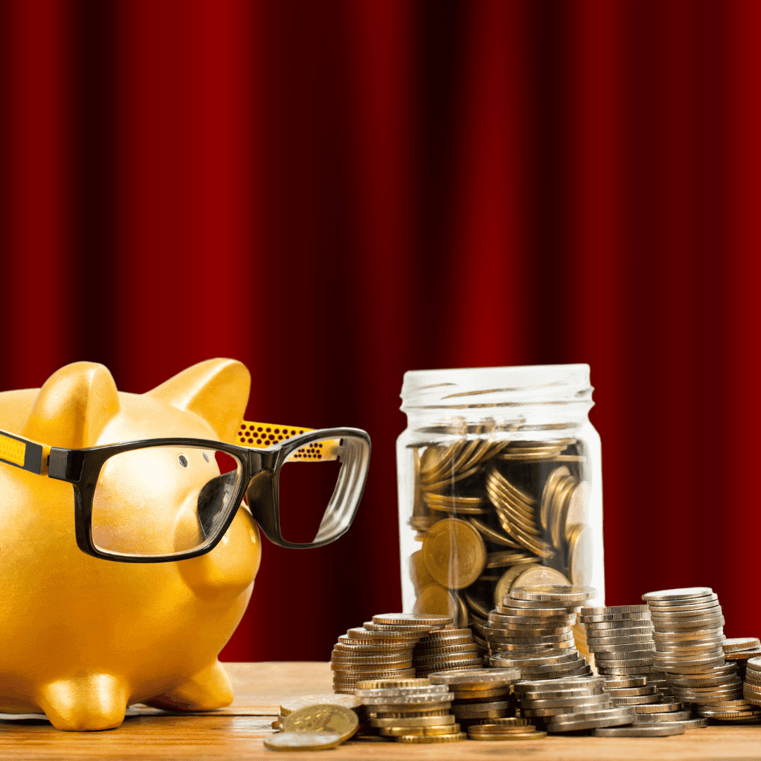 A piggy bank with glasses standing next to a jar filled with coins