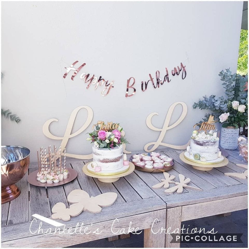 A table with cakes by Chantelle's Cake Creations