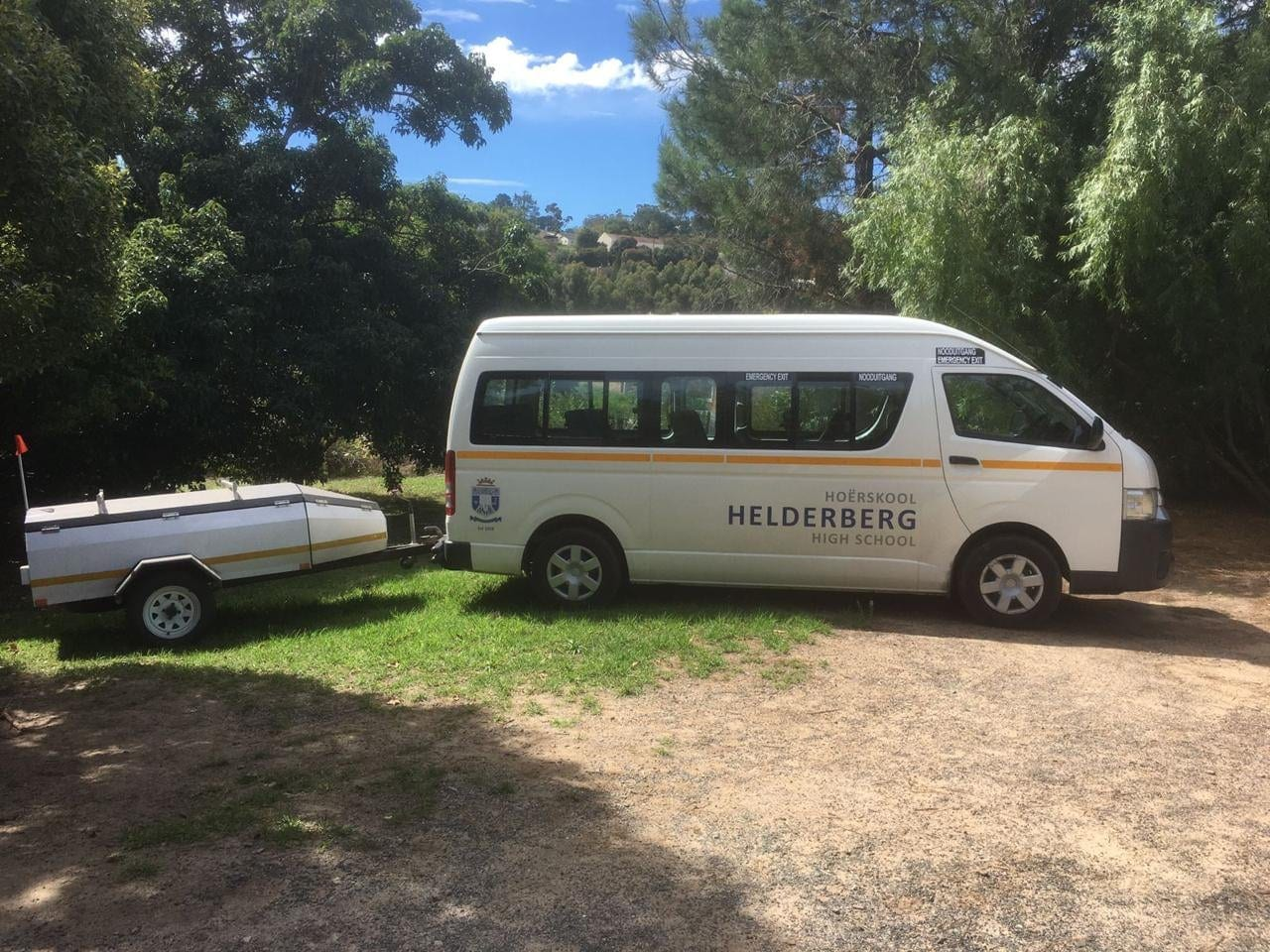 Helderberg High School minibus with trailer outdoors