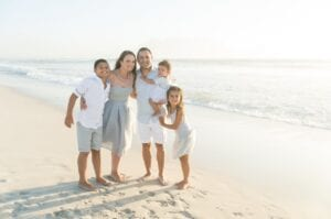 Family portrait on beach taken by Michelle Nadine Photography