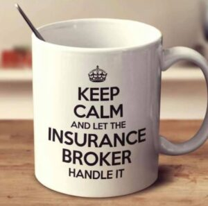 White mug reading keep calm and let the insurance broker handle it