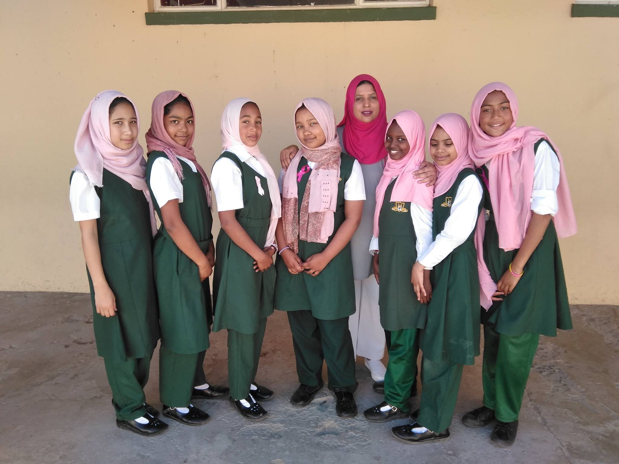 Female learners and a teacher at Strand Muslim Primary School