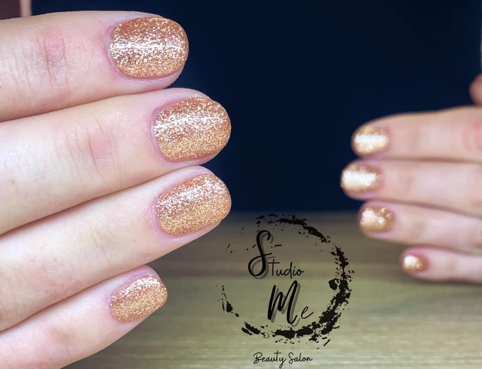 Closeup of sparkly gel nail overlay painted by Marisa from Studio Me Beauty