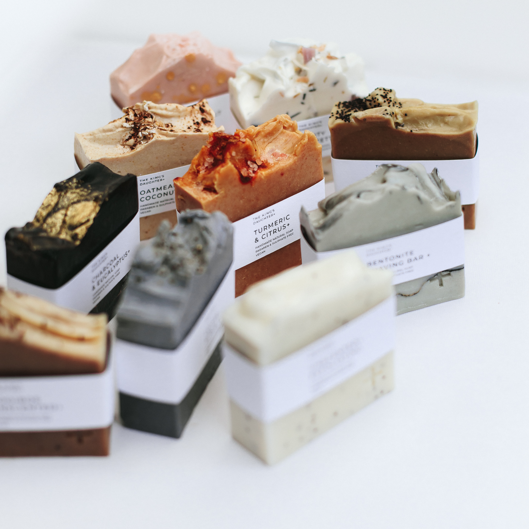 A mix of natural soap bars by The King's Daughter