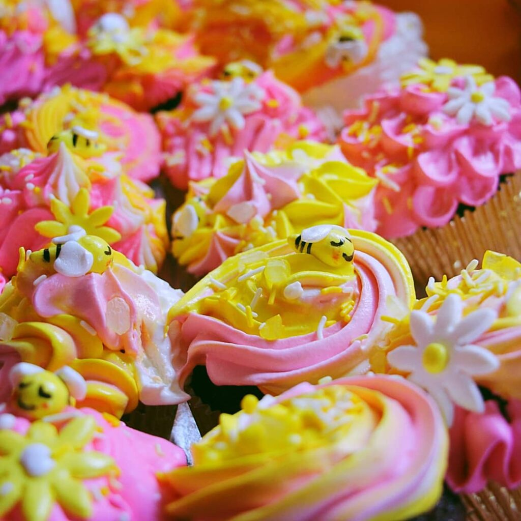 Pink yellow and white floral cupcakes by Flour Child