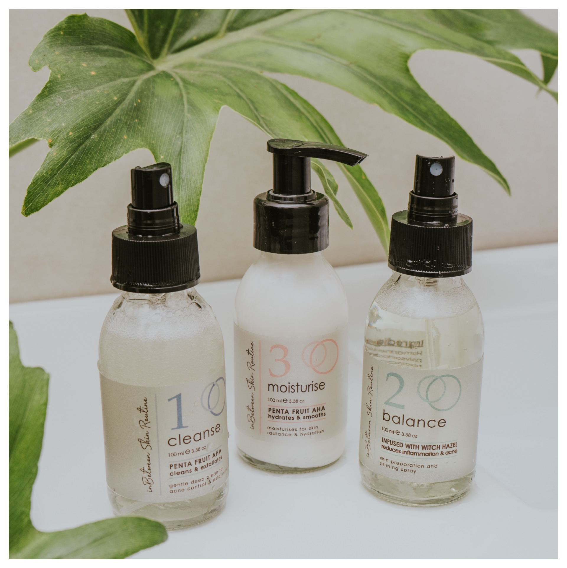 A bottle of cleanser, balancer and moisturizer by In-Between Products